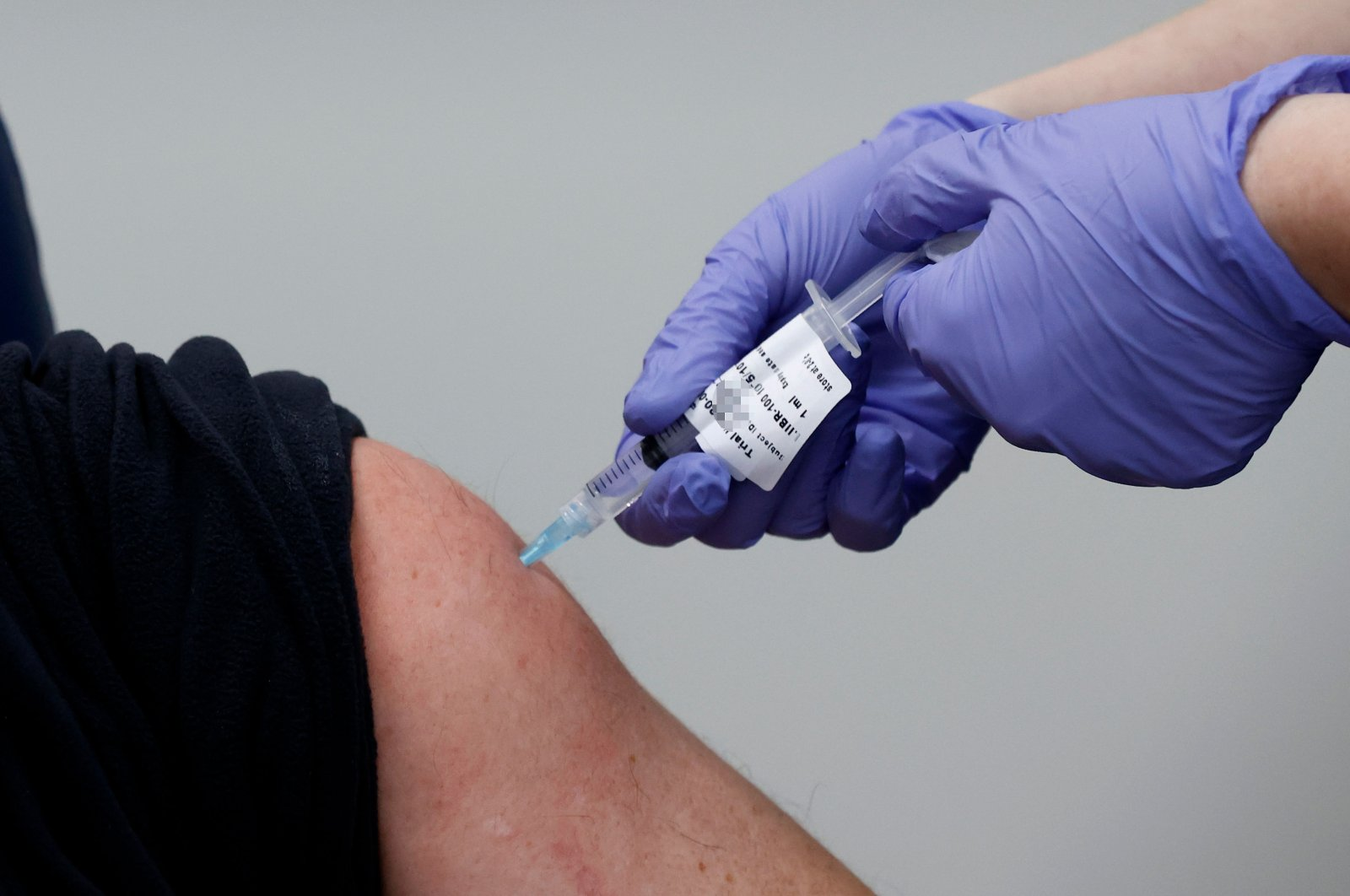 An Israeli volunteer receives the second dose of an experimental Israeli-made COVID-19 vaccine at the Sheba Medical Center, the country's largest hospital, in Ramat Gan near the coastal city of Tel Aviv, on Jan. 14, 2021. (AFP Photo)