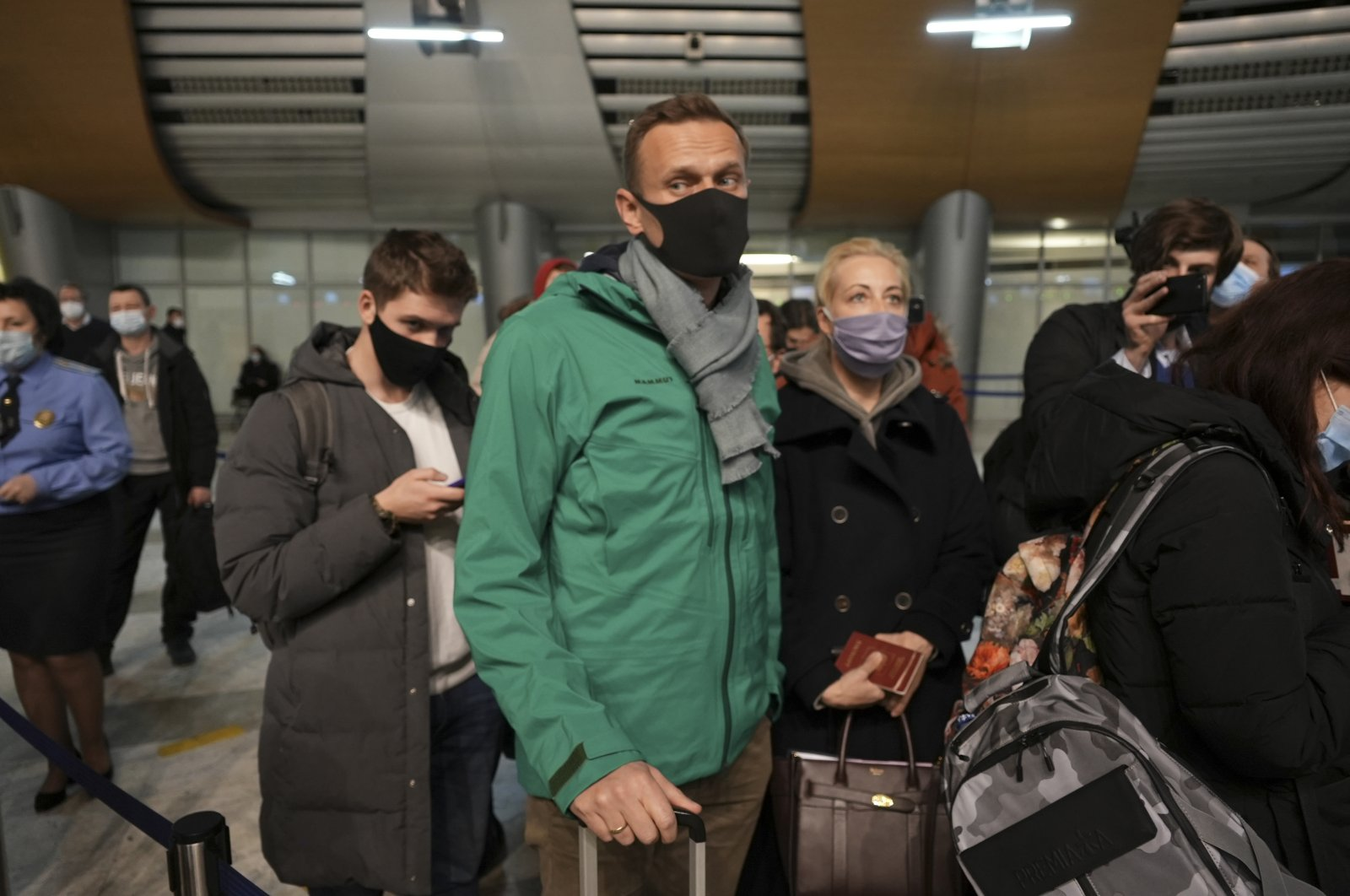 Alexei Navalny and his wife Yuliastand in line at the passport control after arriving at Sheremetyevo airport, outside Moscow, Russia, Sunday, Jan. 17, 2021. (AP Photo)