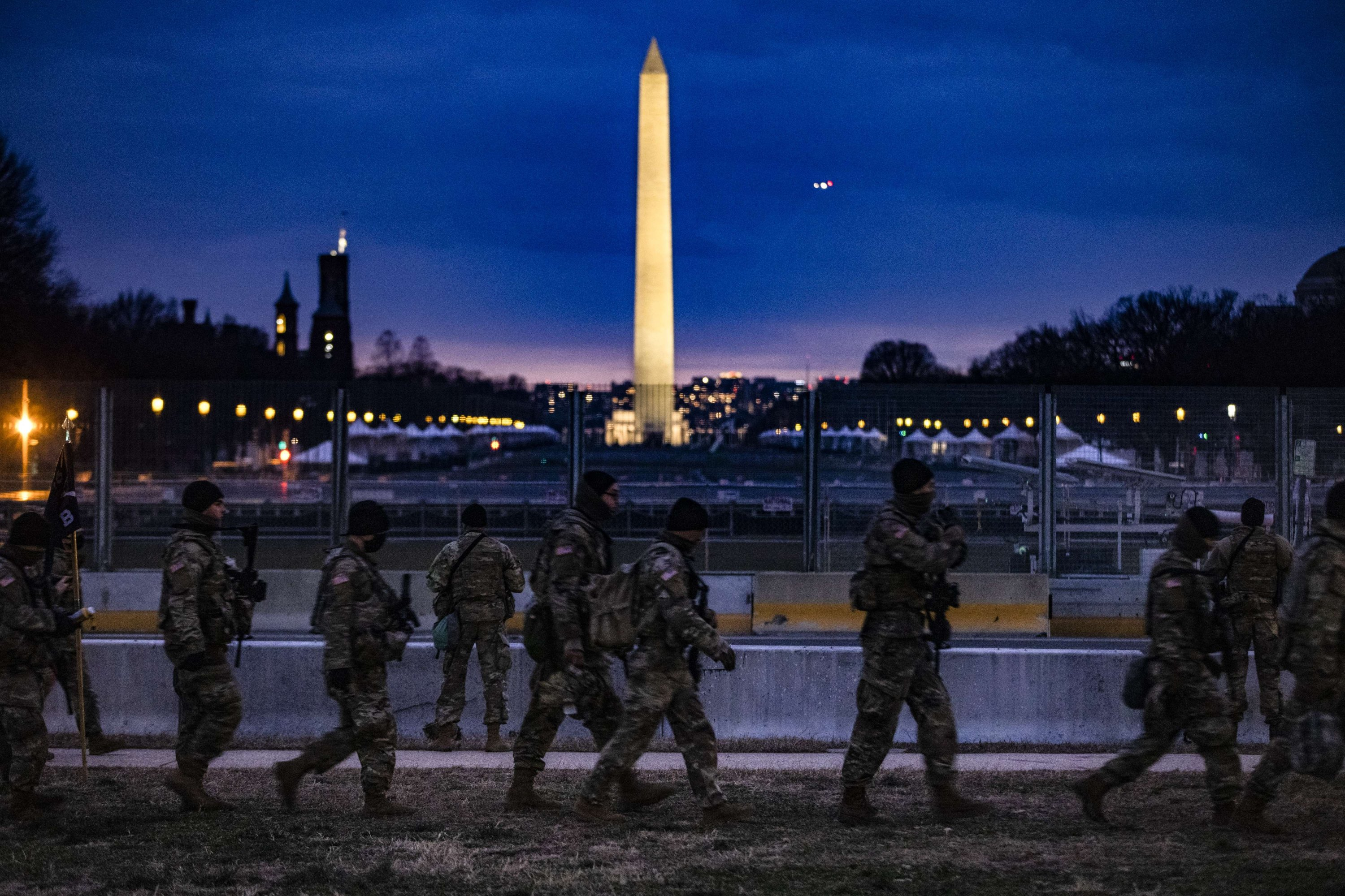 Soldiers from Bravo Company, 1st Battalion, 116th Infantry Brigade Combat Team, Virginia National Guard stand watch on the National Mall in Washington, D.C., U.S., Jan. 17, 2021. (Getty Images/AFP)