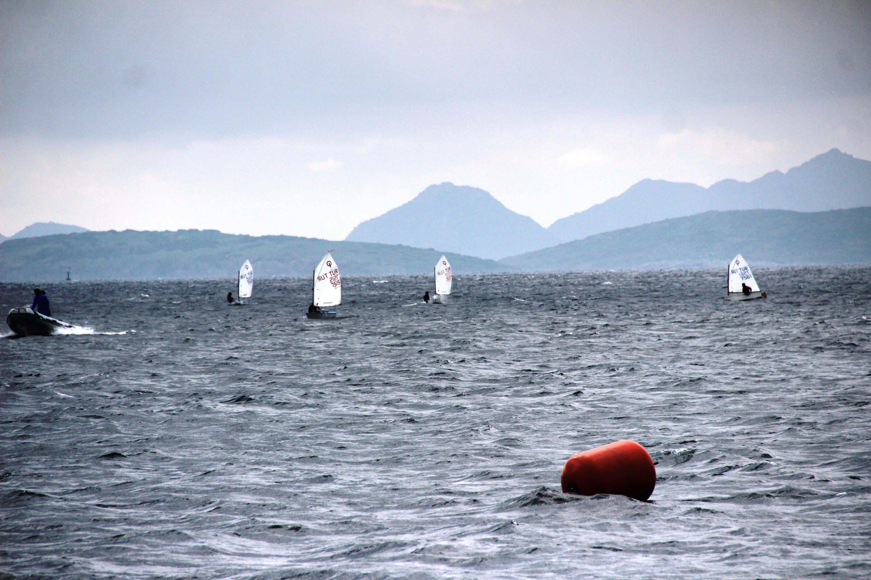 Optimist sailors train at sea off the coast of Bodrum, Muğla, southwestern Turkey, Jan. 9, 2021. (IHA Photo)