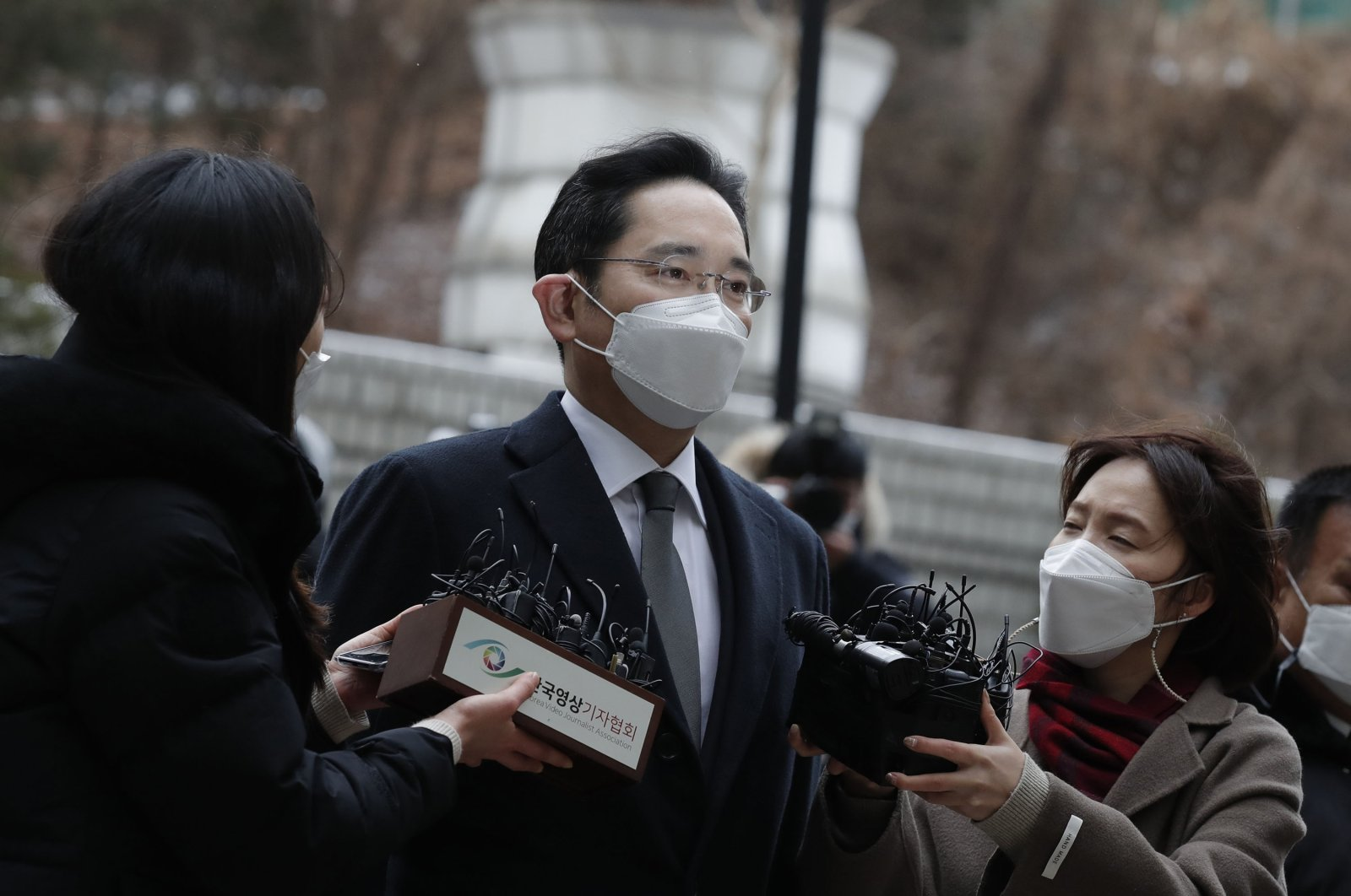 Samsung Electronics Vice Chairman Lee Jae-yong is questioned by reporters upon his arrival at the Seoul High Court in Seoul, South Korea, Jan. 18, 2021. (AP Photo)