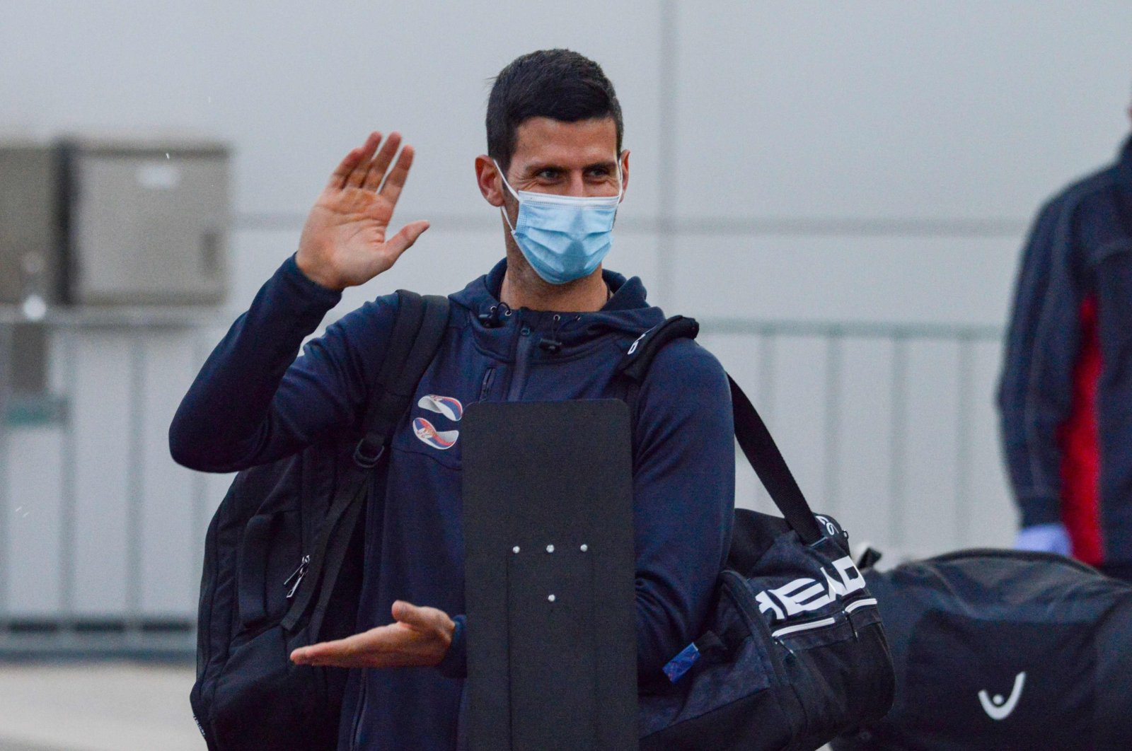 Serbian tennis player Novak Djokovic arrives before heading straight for two-week isolation ahead of Australian Open warm up matches, in Adelaide, Australia, Jan. 14, 2021. (AFP Photo)