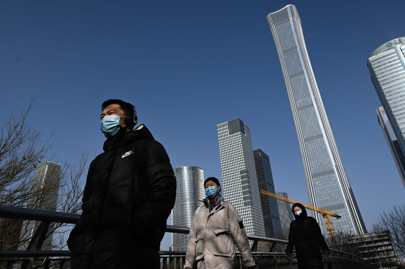 A group of pedestrians walk on an overpass in the central business district in Beijing, China, Jan. 15, 2021. (AFP Photo)