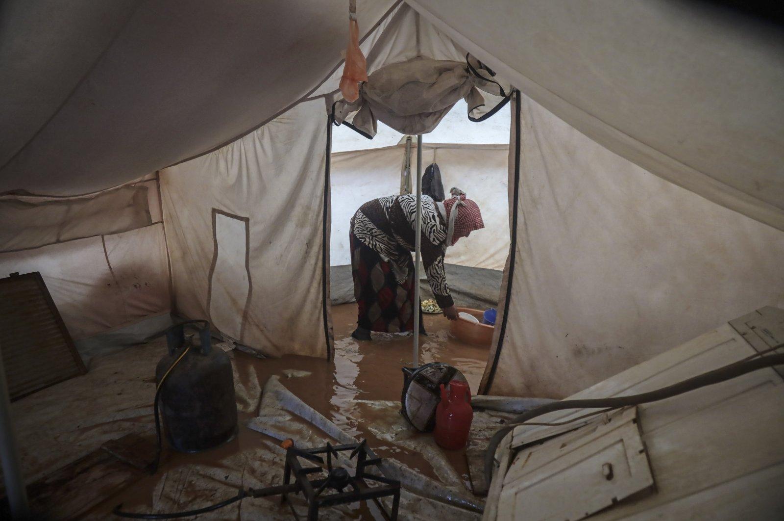 Heavy rains in Syria's northwestern Idlib have flooded around 110 tents belonging to displaced civilians, Jan. 18, 2021. (AA Photo)