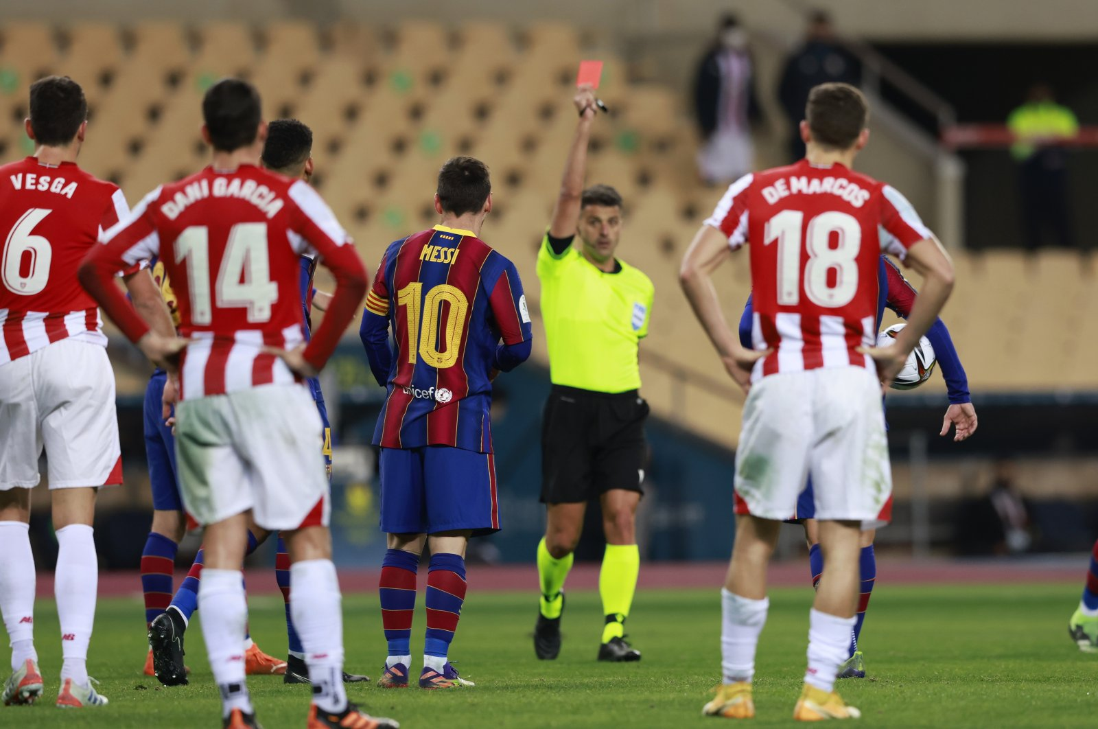 Lionel Messi is shown the first red card in his Barcelona career during the Spanish Super Cup Final between Barcelona and Athletic Bilbao, Estadio La Cartuja de Sevilla, Seville, Spain, Jan. 17, 2021. (Reuters Photo)