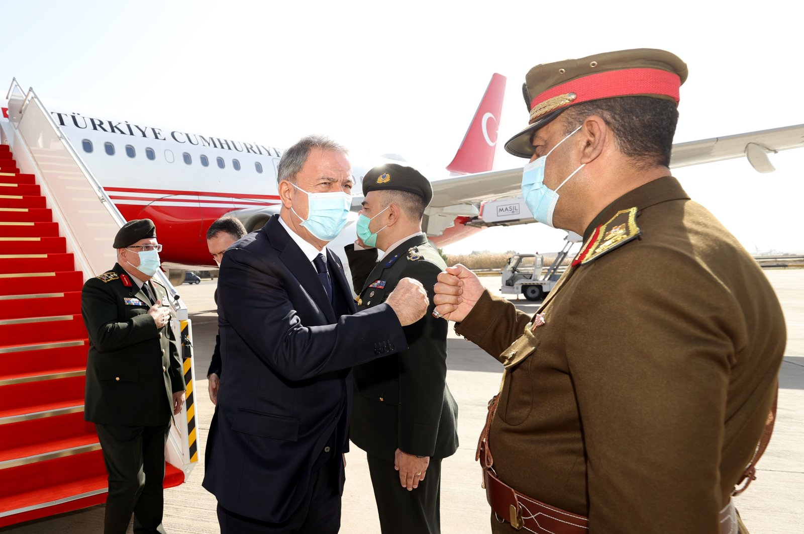 Defense Minister Hulusi Akar is welcomed by Iraqi authorities in the capital Baghdad, Iraq, Jan. 18, 2021. (AA Photo)