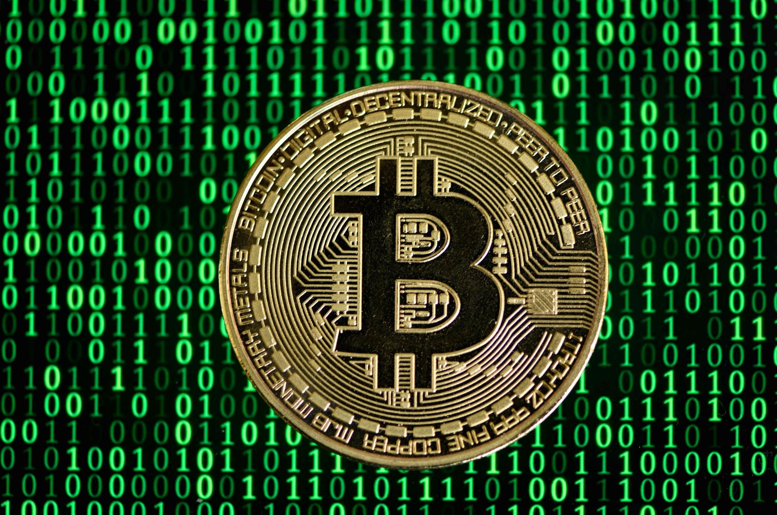 A physical imitation of a bitcoin in a photo taken in Dortmund, western Germany, Jan. 27, 2020. (AFP Photo)