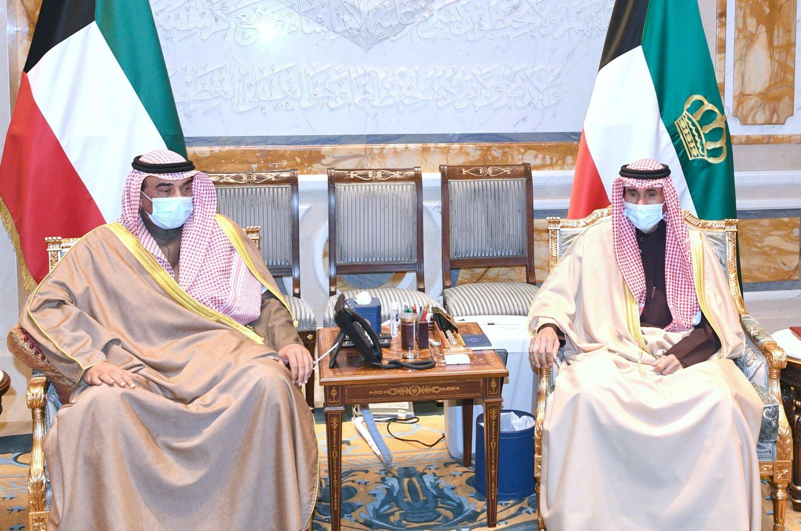 Kuwait's Prime Minister Sabah Al Khalid Al Sabah meets with Emir Sheikh Nawaf Al Ahmed Al Sabah to present the resignation of his Cabinet, in Kuwait City, Kuwait Jan. 13, 2021. (Kuwait News Agency/Al-Diwan Al-Amiri/Handout via Reuters)