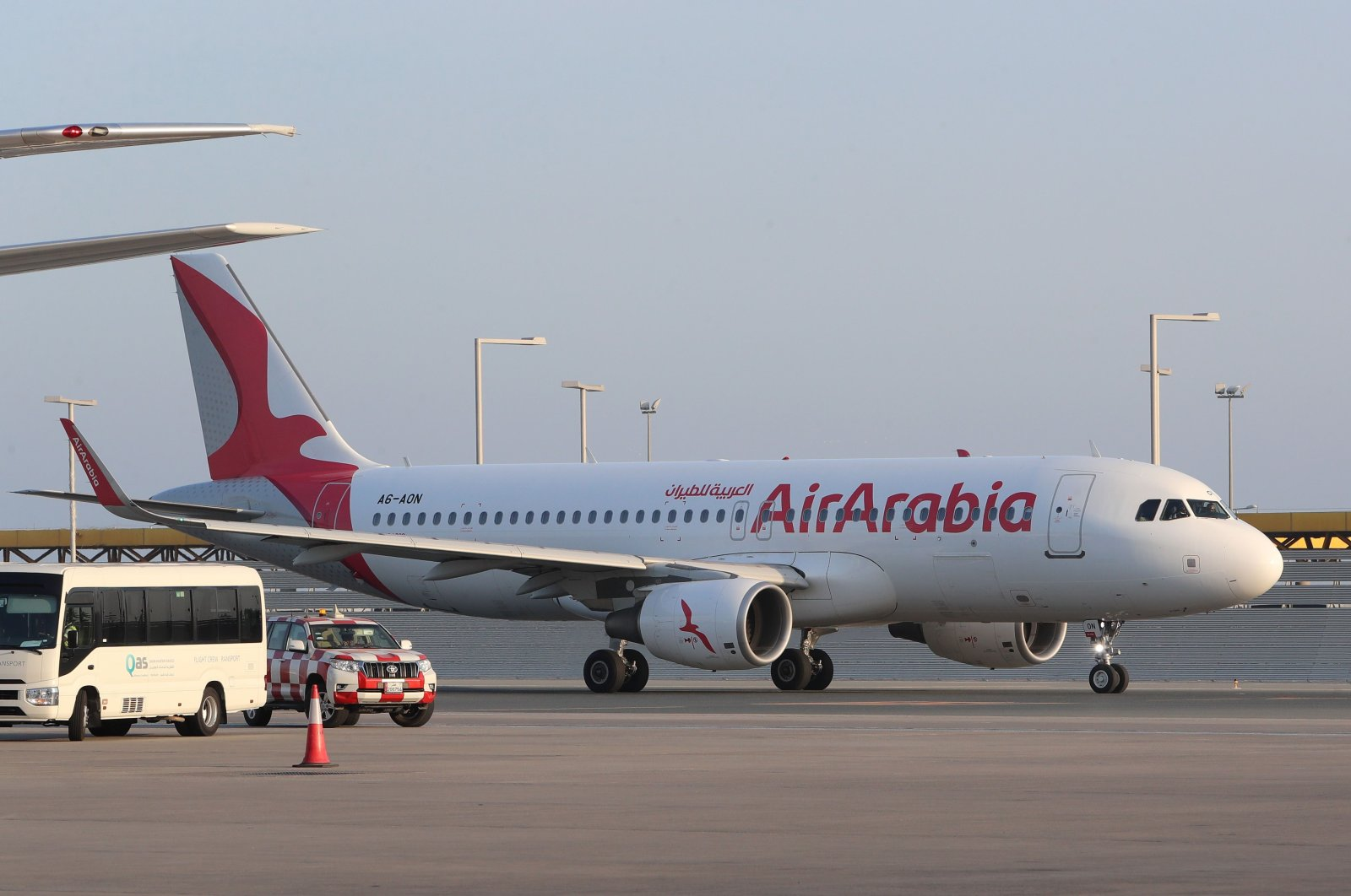 An Air Arabia Airbus A320 aircraft is seen taxiing at Qatar's Hamad International Airport near the capital Doha on Jan. 18, 2021. (AFP Photo)