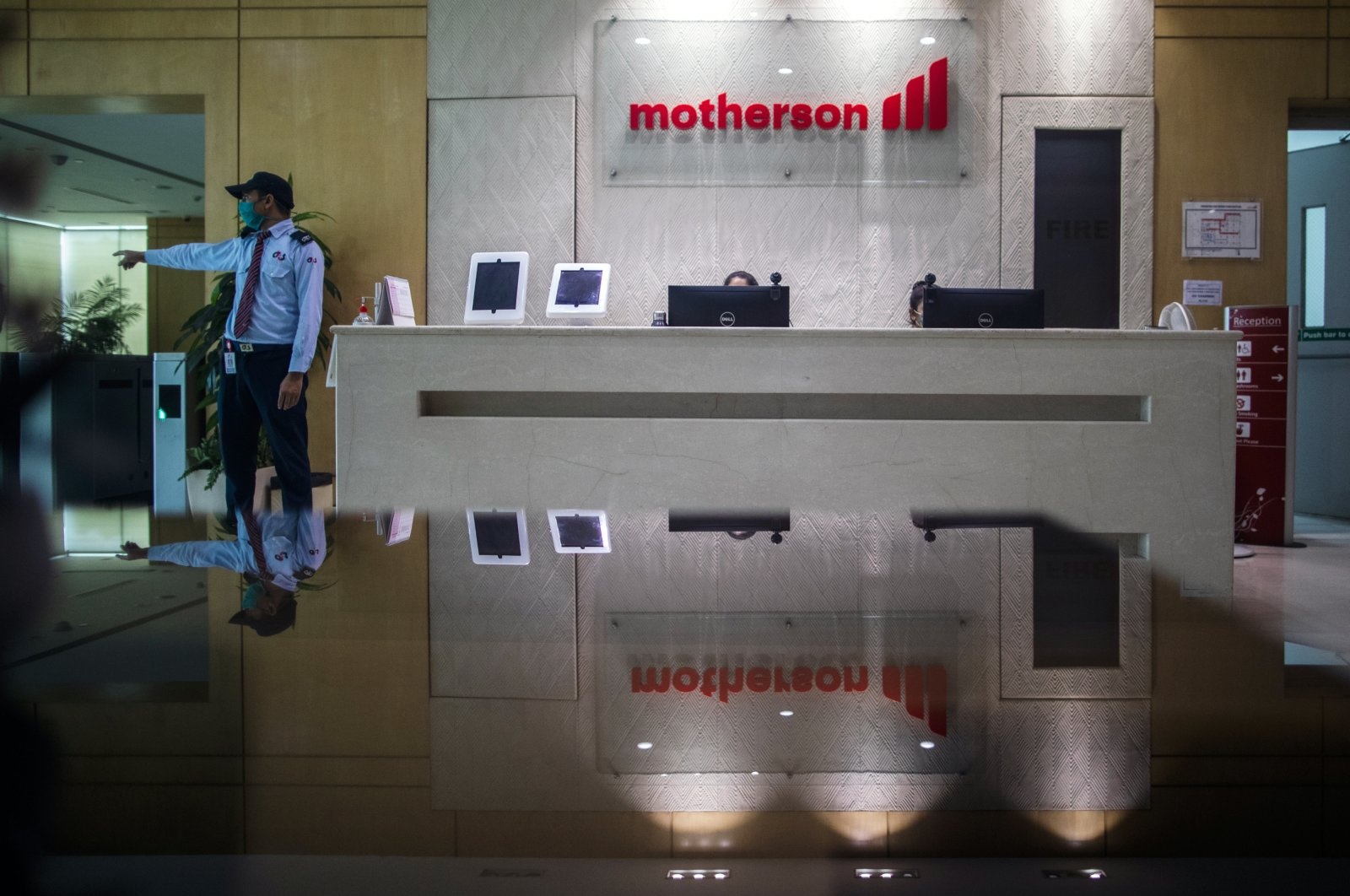 Employees work at the reception area of the Motherson Group head office in Noida, Uttar Pradesh, India, Aug. 17, 2020.  (Getty Images)