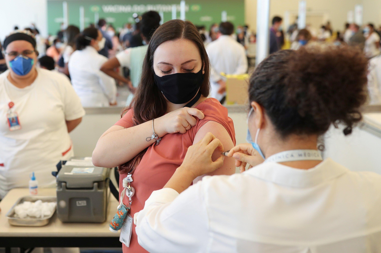 A healthcare worker receives the Sinovac coronavirus disease (COVID-19) vaccine at the Hospital das Clinicas in Sao Paulo, Brazil, Jan. 18, 2021. (REUTERS Photo)