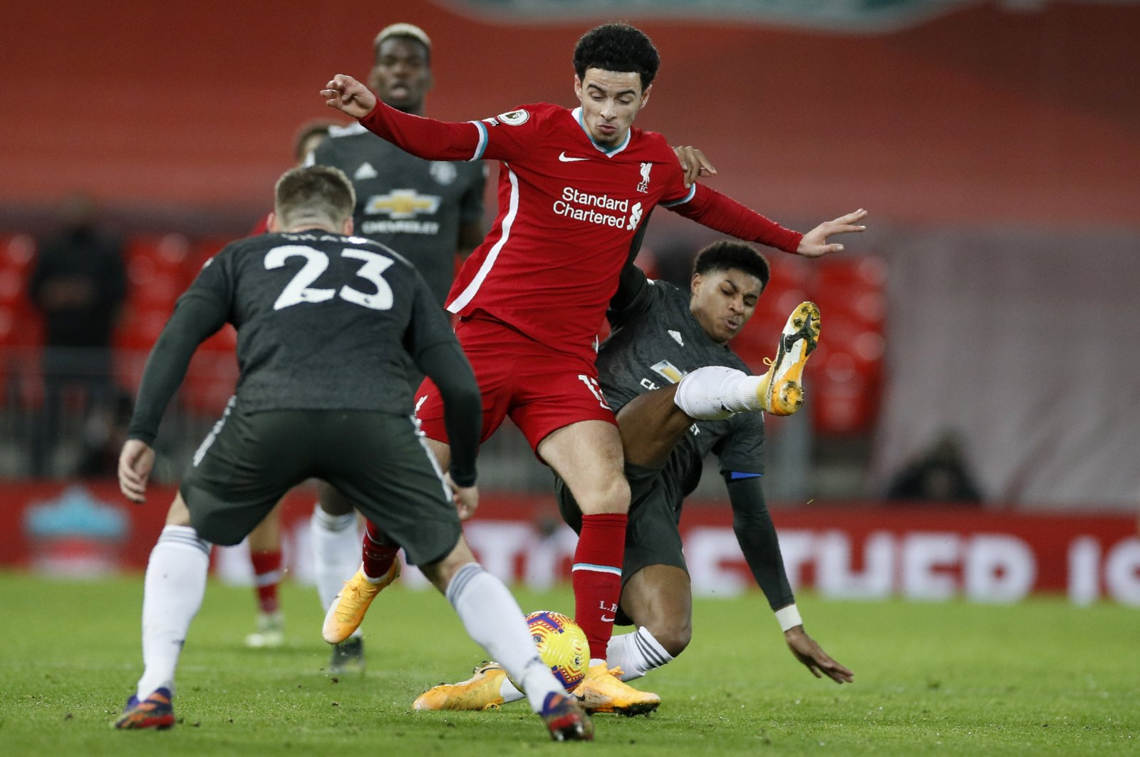 Manchester United's Marcus Rashford (R) vies for the ball with Liverpool's Curtis Jones during their English Premier League match at the Anfield, Liverpool, England, Jan. 17, 2021.(AP Photos)