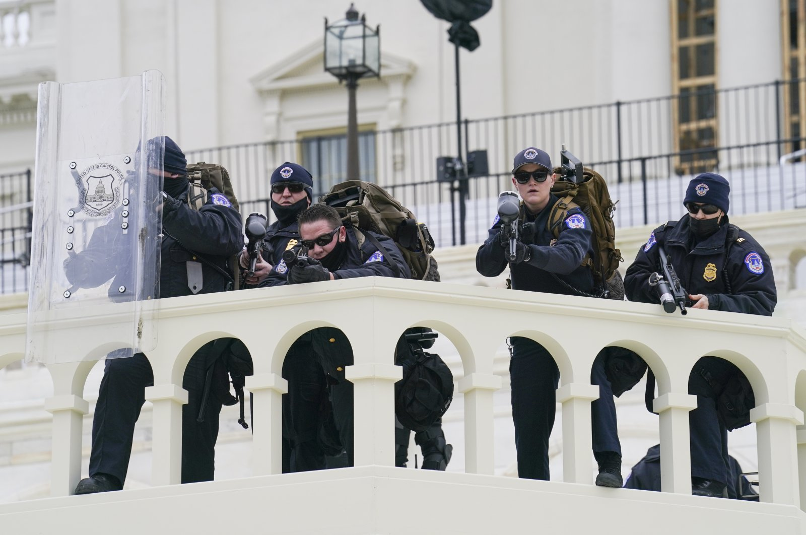 Security officers point guns before pro-Trump supporters successfully breaching the U.S. Capitol building, Washington, D.C., U.S., Jan. 6, 2021. (AP Photo)