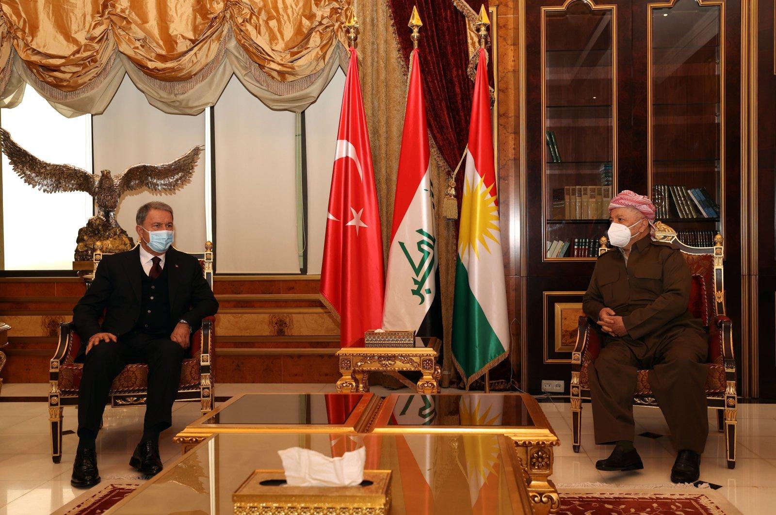 Defense Minister Hulusi Akar (L) and former Kurdish Regional Government (KRG) President Masoud Barzani hold a meeting in the KRG capital Irbil, Jan. 19, 2020. (AA Photo)