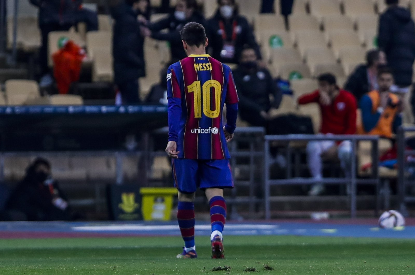 Barcelona's Lionel Messi walks out of the pitch after being sent off during the Spanish Super Cup final against Athletic Bilbao at La Cartuja Stadium, Seville, Spain, Jan. 17, 2021. (AP Photo)
