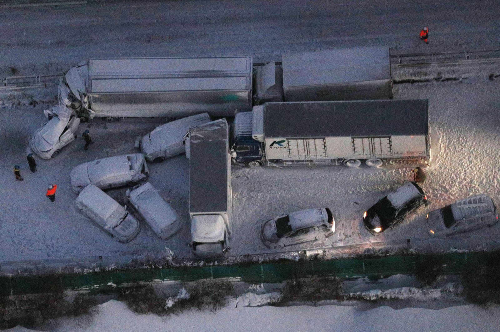 Damaged cars covered with snow after the accident on the Tohoku Expressway in Osaki city, Miyagi prefecture, northern Japan, Tuesday, Jan. 19. 2021. (Kyodo News via AP)