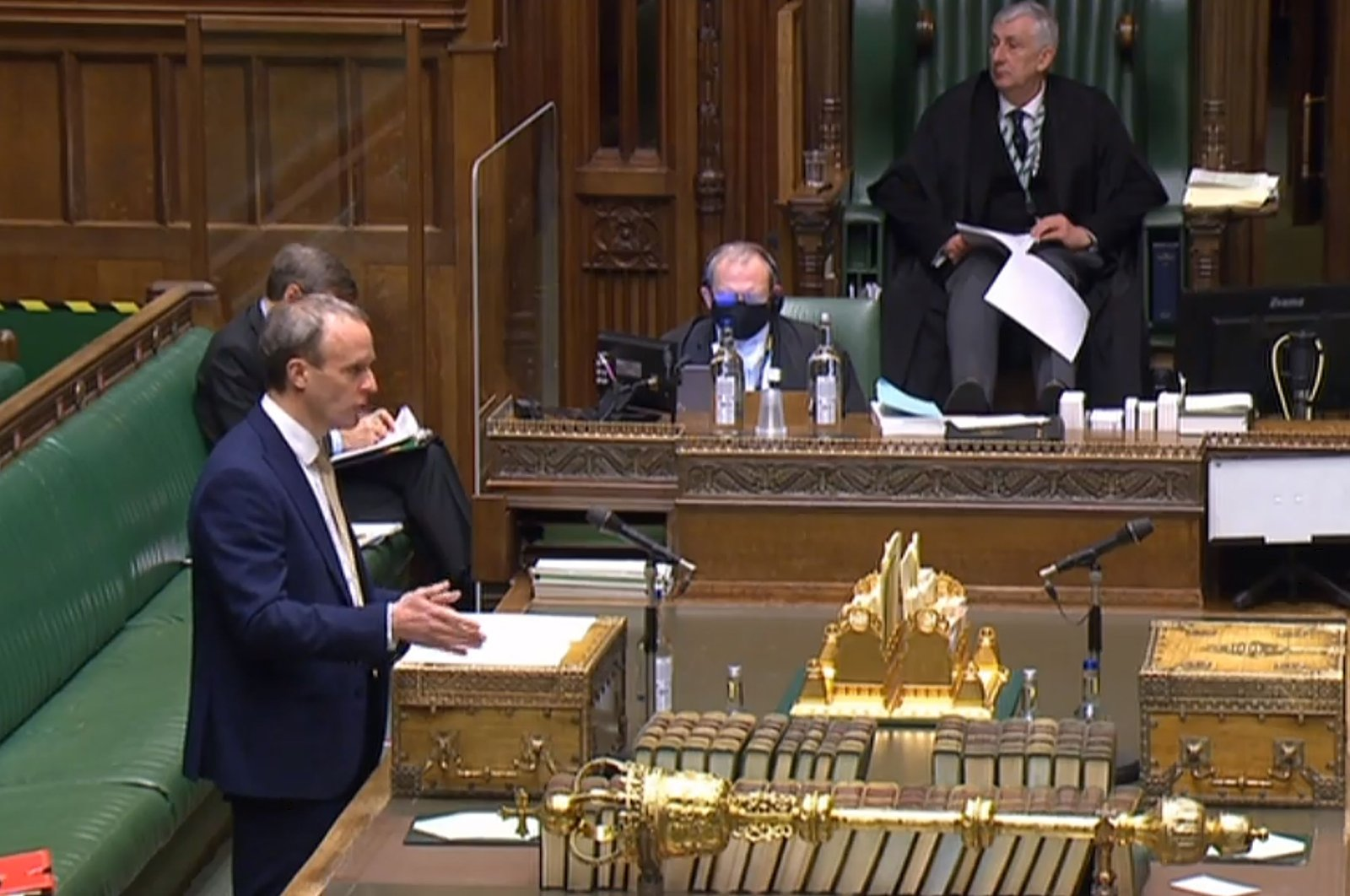 """A video grab from footage broadcast by the U.K. Parliament's Parliamentary Recording Unit (PRU) shows Britain's Foreign Secretary Dominic Raab as he makes a statement on trade measures over alleged Chinese human rights violations against its Uighur minority in a hybrid, socially distanced session at the House of Commons, in London, on Jan. 12, 2021.   Britain on January 12 accused China of human rights violations against its Uighur minority, as it announced new rules to ban imports of goods suspected of using forced labor. The abuses were """"on an industrial scale,"""" Foreign Secretary Dominic Raab told parliament, adding that Britain had a """"moral duty to respond."""" (Photo by - / PRU / AFP) / RESTRICTED TO EDITORIAL USE - MANDATORY CREDIT """" AFP PHOTO / PRU """" - NO USE FOR ENTERTAINMENT, SATIRICAL, MARKETING OR ADVERTISING CAMPAIGNS"""