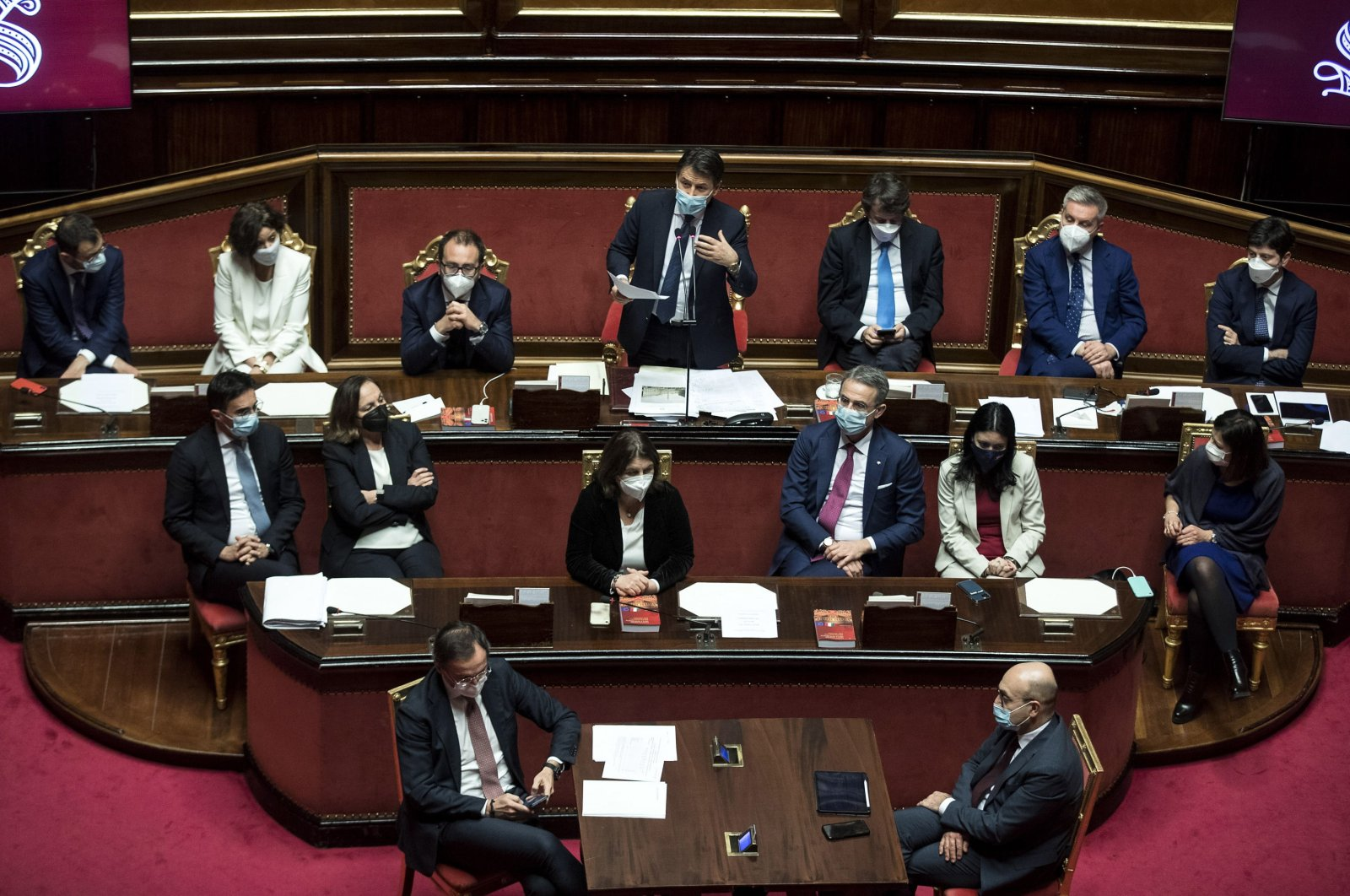 Italian Prime Minister Giuseppe Conte stands in the back row) during a debate in the Senate in Rome, Italy, Jan. 19, 2021. (EPA Photo)