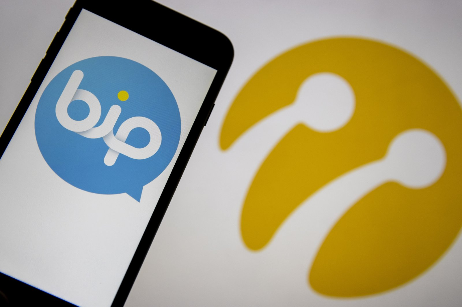 The logo of the Turkish messaging app BiP on a phone screen in front of the Turkcell logo in this illustration photo, Jan. 16, 2021. (AA Photo)