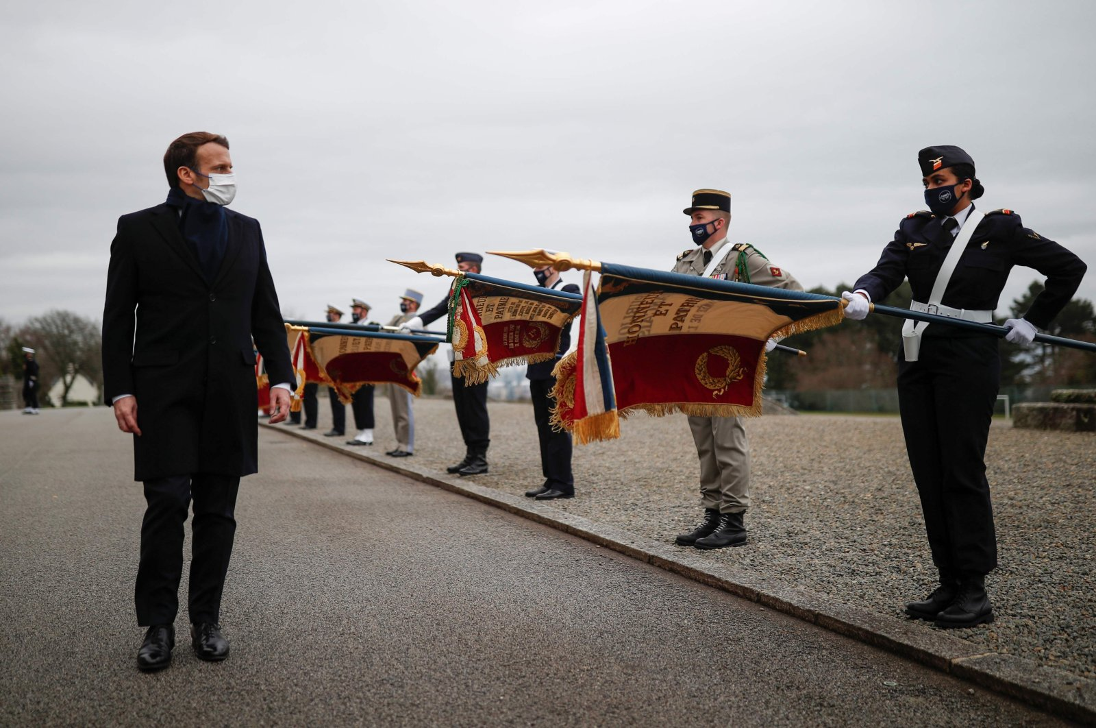 French President Emmanuel Macron observes troops during a military ceremony before the presentation of his New Year's wishes to the military forces in Brest, France, Jan. 19, 2021. (AFP Photo)