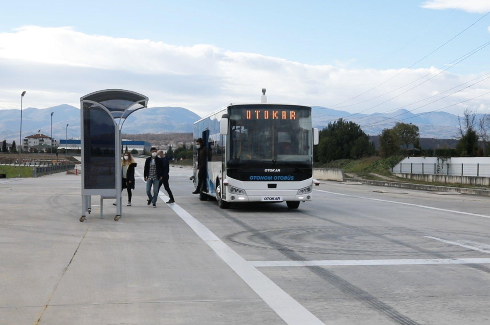 Passengers get off Turkey's first autonomous bus, manufactured by Otokar, Jan. 15, 2021. (Courtesy of Otokar)