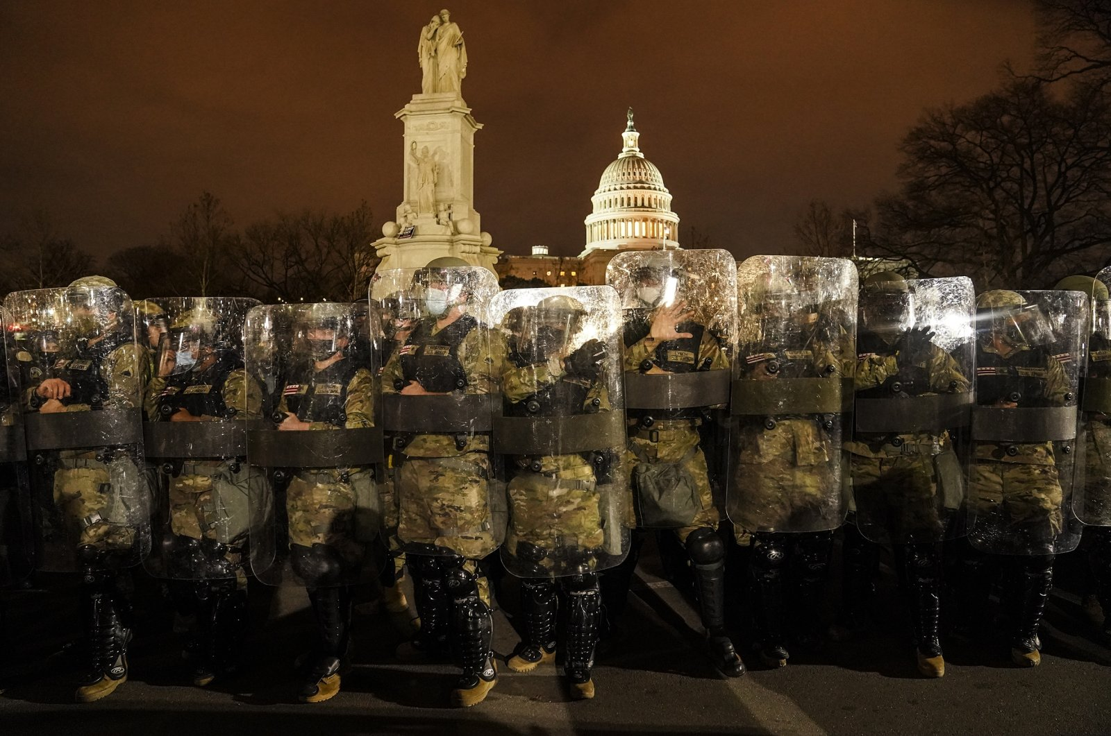 National Guards stand outside the U.S. Capitol, after a day of storming, Washington, D.C., U.S., Jan. 6, 2021. (AP Photo)