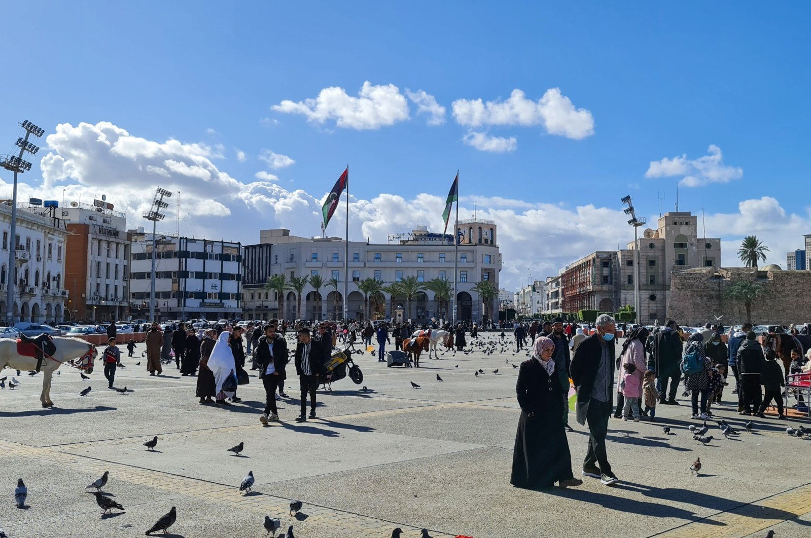 People walk in the Martyr's Square in the capital Tripoli, Libya, Jan. 19, 2021. (AFP Photo)