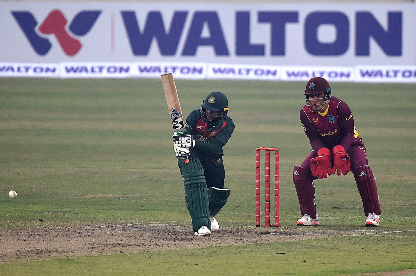 Bangladesh's Shakib Al Hasan (L) bats in the first one-day international (ODI) cricket match between Bangladesh and West Indies at the Sher-e-Bangla National Cricket Stadium, Dhaka, Jan. 20, 2021. (AFP Photo)