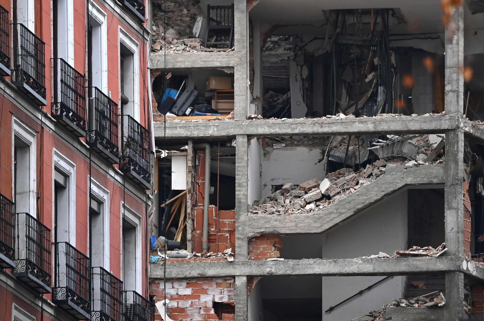 A damaged building is pictured in Madrid on January 20, 2021 after a strong explosion rocked the building. (AFP Photo)