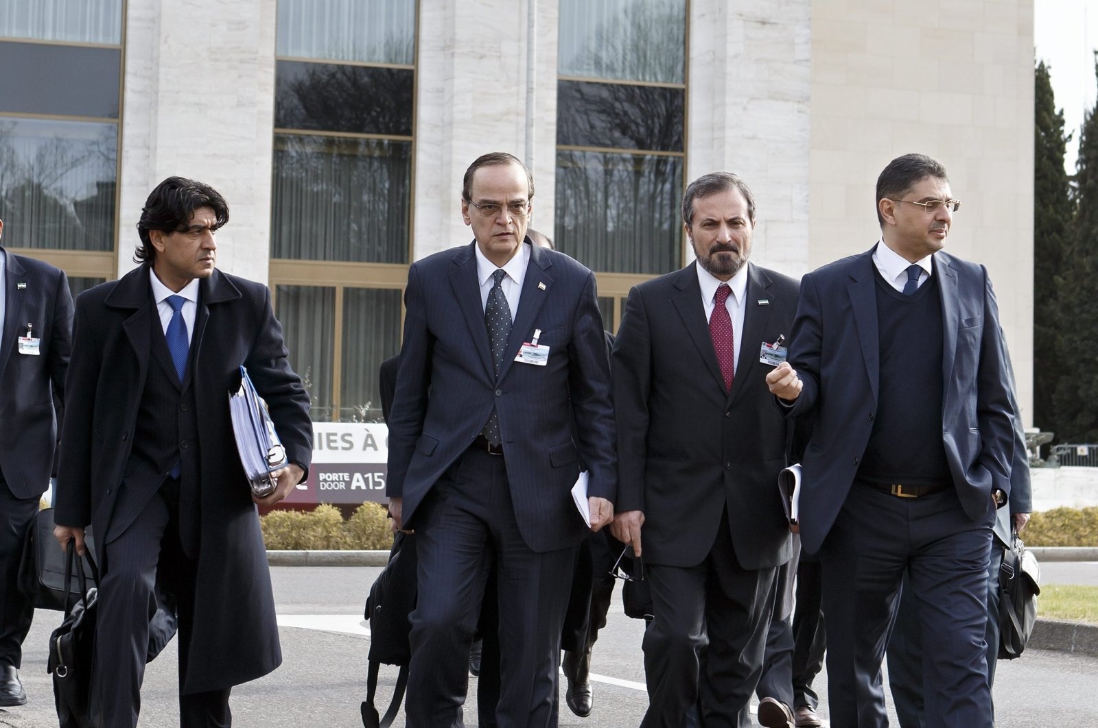 Syrian opposition chief negotiator Hadi al-Bahra (C-L) and Syrian National Coalition spokesperson Louay Safi (C-R) leave after a meeting at the European headquarters of the United Nations in Geneva, Switzerland, Jan. 26, 2014. (EPA Photo)