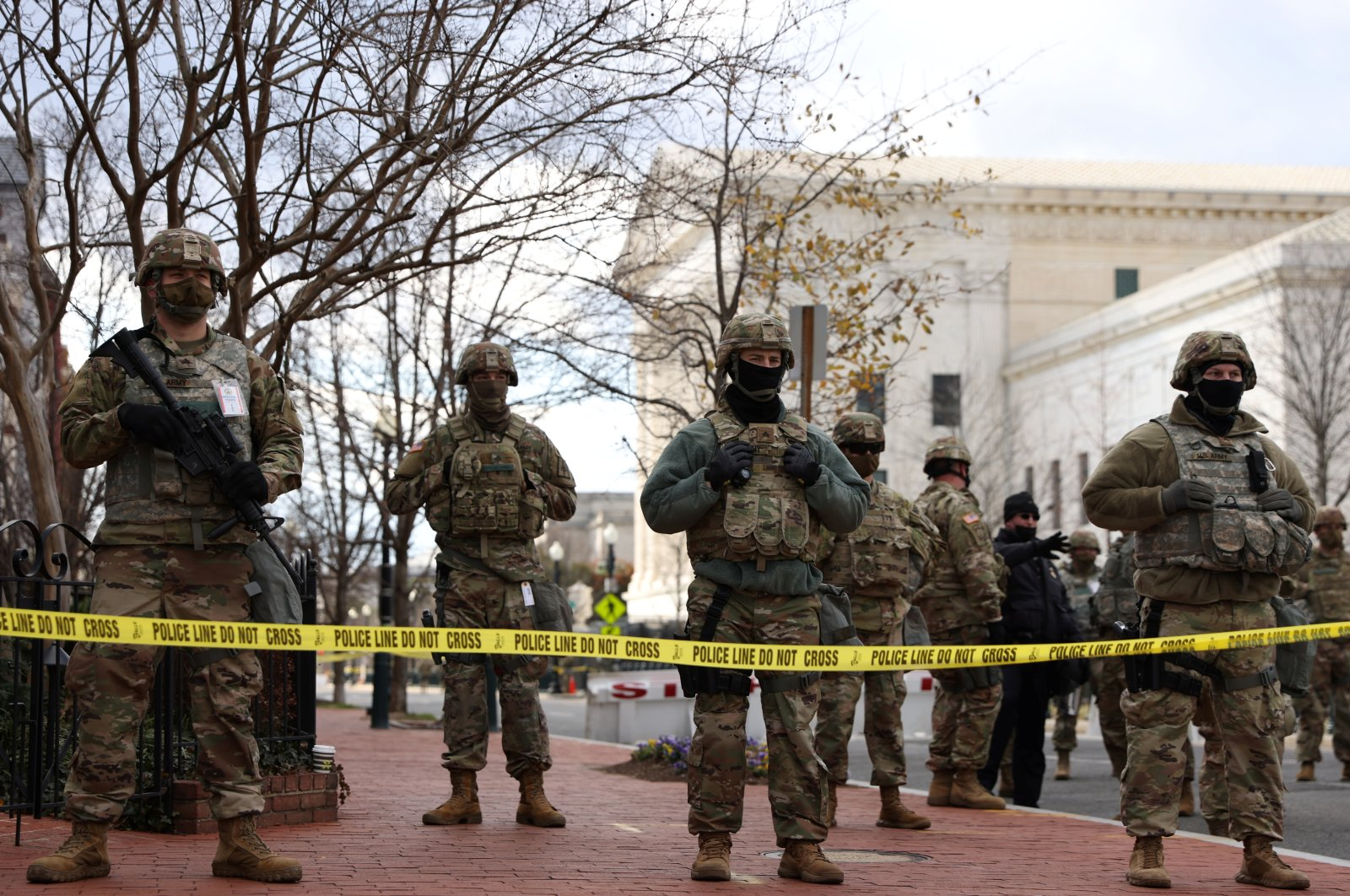Members of the National Guard stand watch wearing helmets in front of the Supreme Court after reports of a bomb threat circulated hours before President-elect Joe Biden's inauguration as the 46th President of the United States, in Washington D.C., U.S. Jan. 20, 2021. (REUTERS Photo)