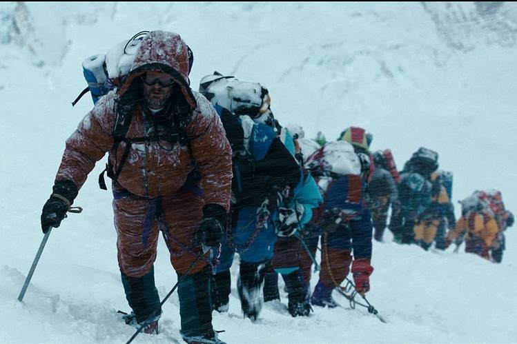 """Still shot shows the climbers struggling to the summit of Everest in Baltasar Kormakur's """"Everest.'"""