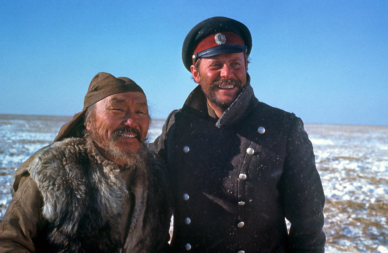 Maxim Munzuk (L) as Dersu Uzala and Yury Mefodievich Solomin as Commander Arsenev in a scene from 'Dersu Uzala.'