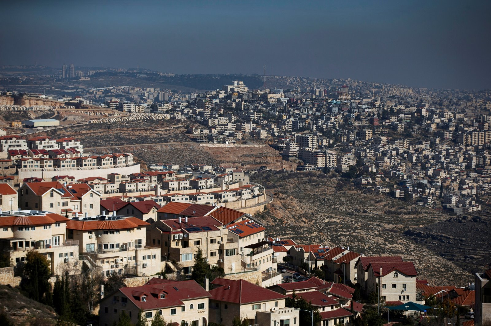 A general view shows the Israeli settlement of Efrat (L) in the Gush Etzion settlement block as Bethlehem is seen in the background, in the Israeli-occupied West Bank, Palestine, Jan. 28, 2020. (Reuters Photo)