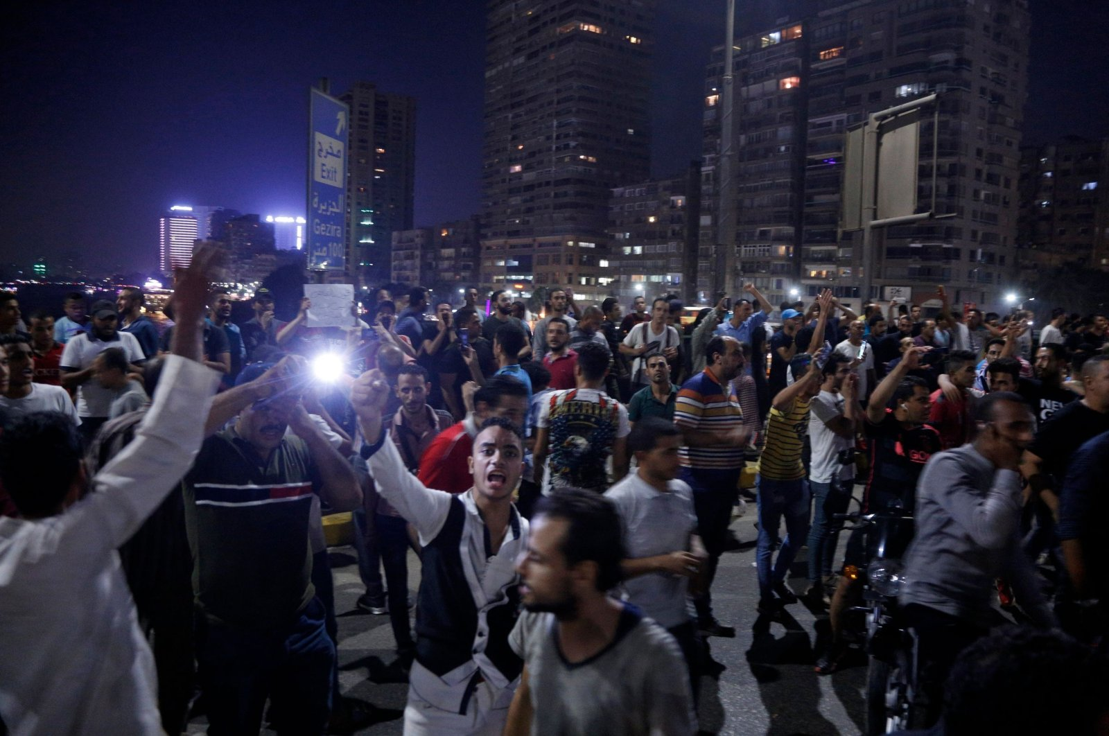 Egyptian protesters shout slogans as they take part in a demonstration calling for the removal of President Abdel-Fattah el-Sissi, Sep. 22, 2019. (AFP Photo)