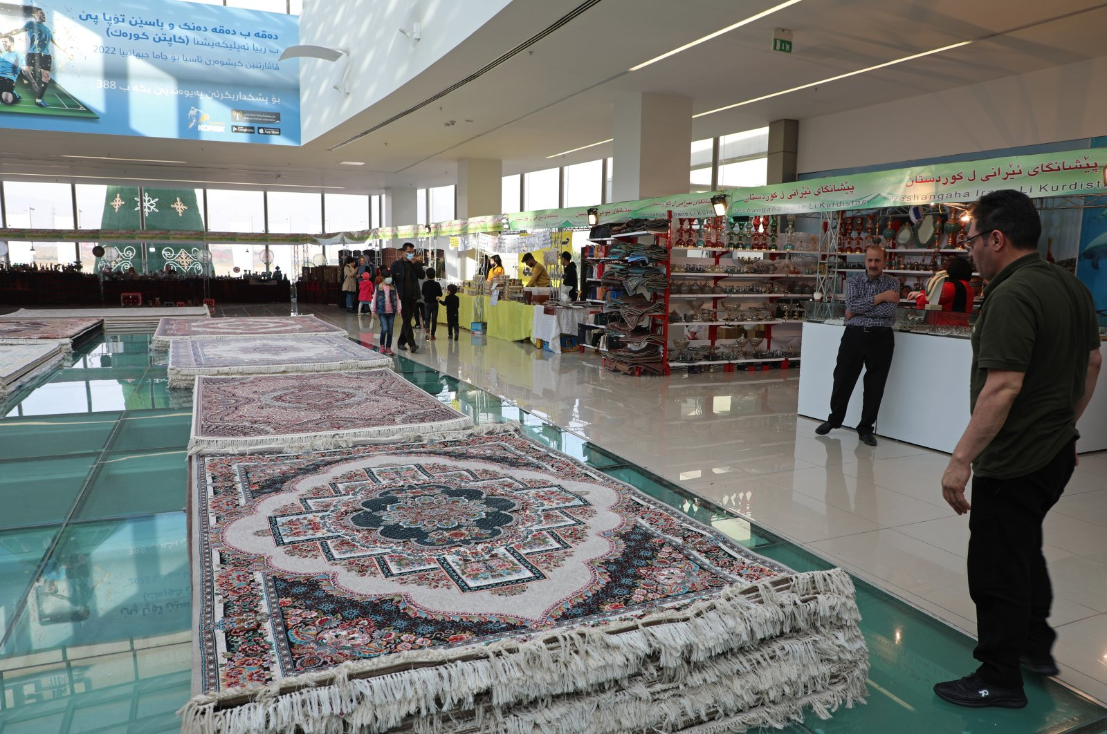 Piles of plush Iranian-made carpets line the floors of a shopping center in northern Iraq, hosting traders from neighboring Iran, in the city of Dohuk, in the Kurdish-run northern region of Iraq, Jan. 20, 2021. (AP Photo)