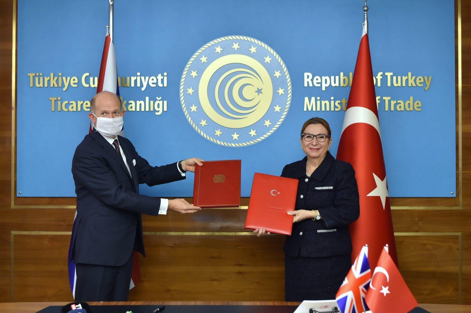 U.K. Ambassador to Ankara Dominick Chilcott (L) and Turkey's Trade Minister Ruhsar Pekcan at the signing ceremony of the Turkey-U.K. free trade agreement in the capital Ankara, Turkey, Dec. 29, 2020. (AA Photo)