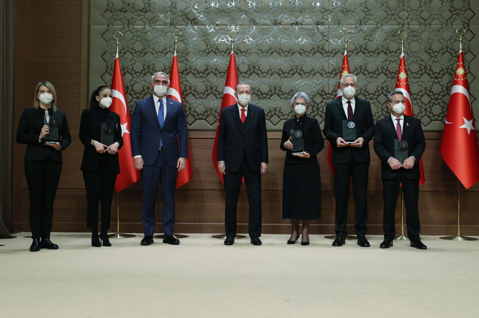 President Recep Tayyip Erdoğan and Culture and Tourism Minister Mehmet Nuri Ersoy pose with the prize winners at the Presidential Conference Hall, Ankara, Turkey, Jan. 20, 2021. (DHA PHOTO)