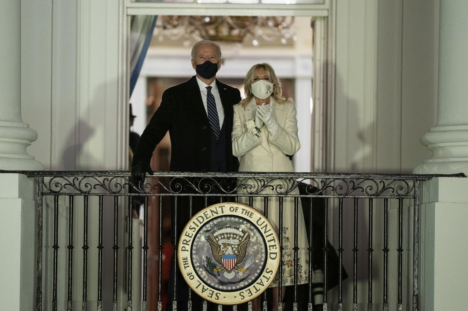 U.S. President Joe Biden and first lady Jill Biden watch fireworks from the White House, Washington, D.C., U.S., Jan. 20, 2021. (AP Photo)