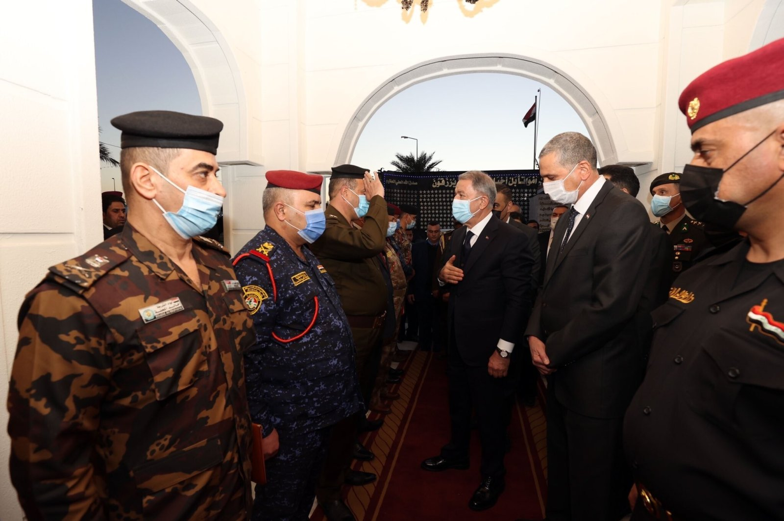 Defense Minister Hulusi Akar, alongside a Turkish delegation, meets with Iraqi Interior Minister Othman al-Ghanmi and Iraqi soldiers during a visit to Baghdad, Iraq, Jan. 18, 2021. (IHA Photo)