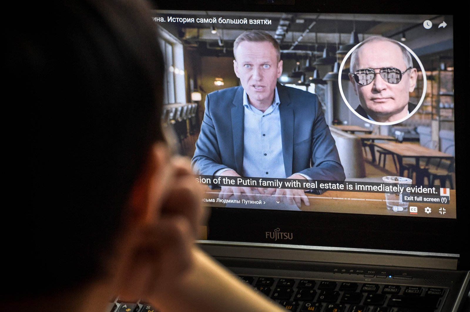 A woman watches an investigative film by Russian opposition leader Alexei Navalny in Moscow, Jan. 21, 2021. (AFP Photo)