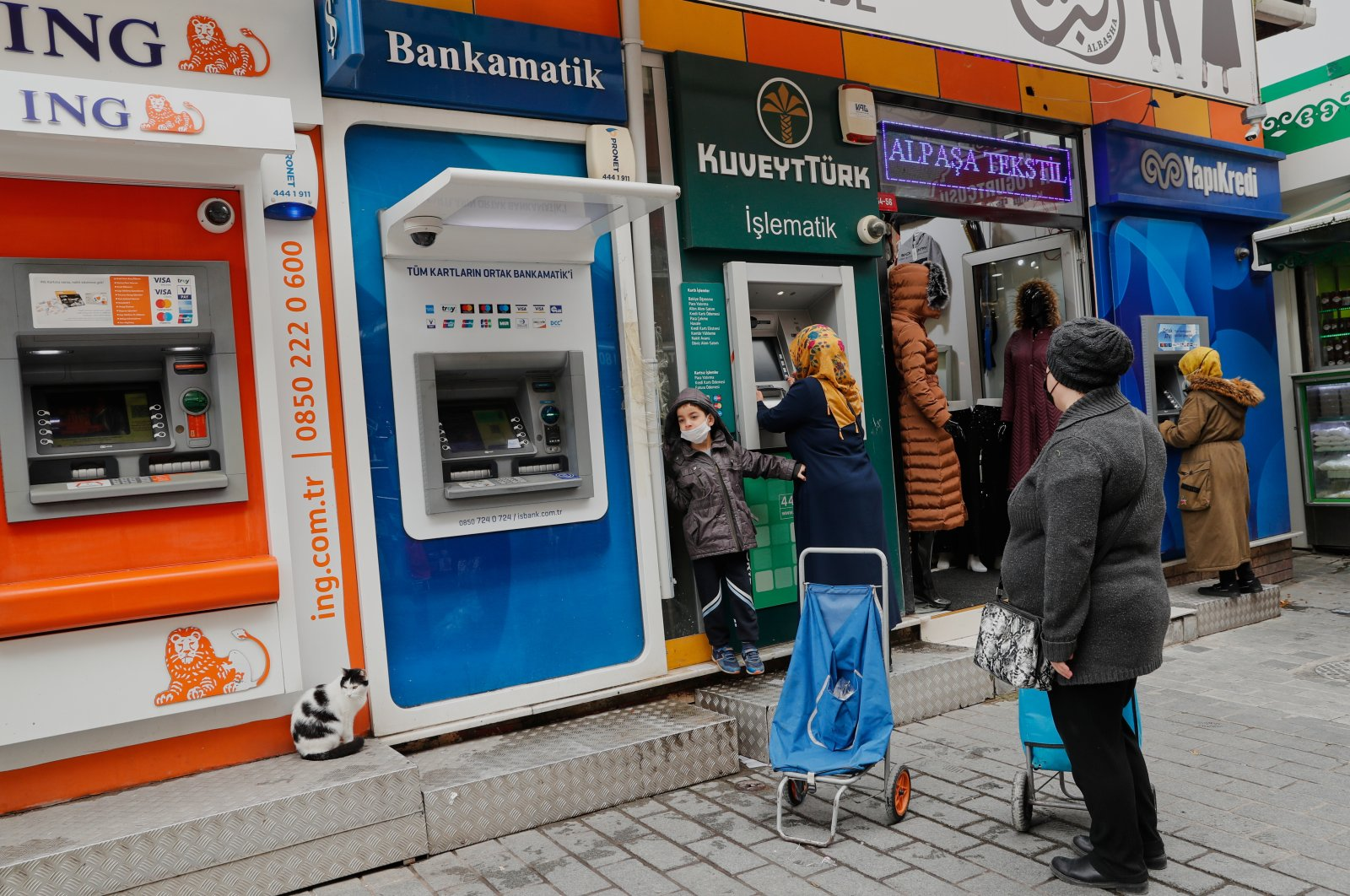 Women withdraw money from ATMs amid the spread of COVID-19 in Istanbul, Turkey, Jan. 13, 2021. (Reuters Photo)