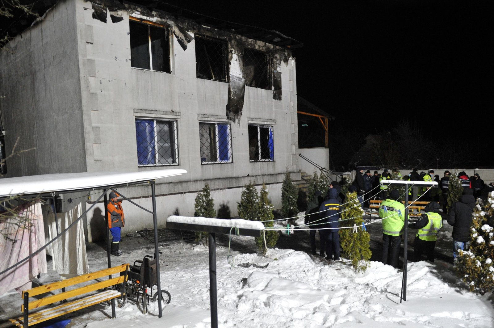 Police experts and members of emergency services work on the the site of a fire that broke out in a nursing home, in Kharkiv, Ukraine, Jan. 21, 2021. (AFP Photo)