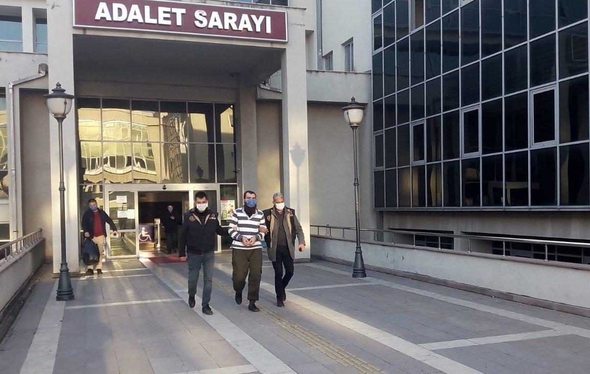 Police escort suspected Daesh terrorist C.A. out of the court in Osmaniye province, Turkey, Jan. 22, 2020. (IHA Photo)