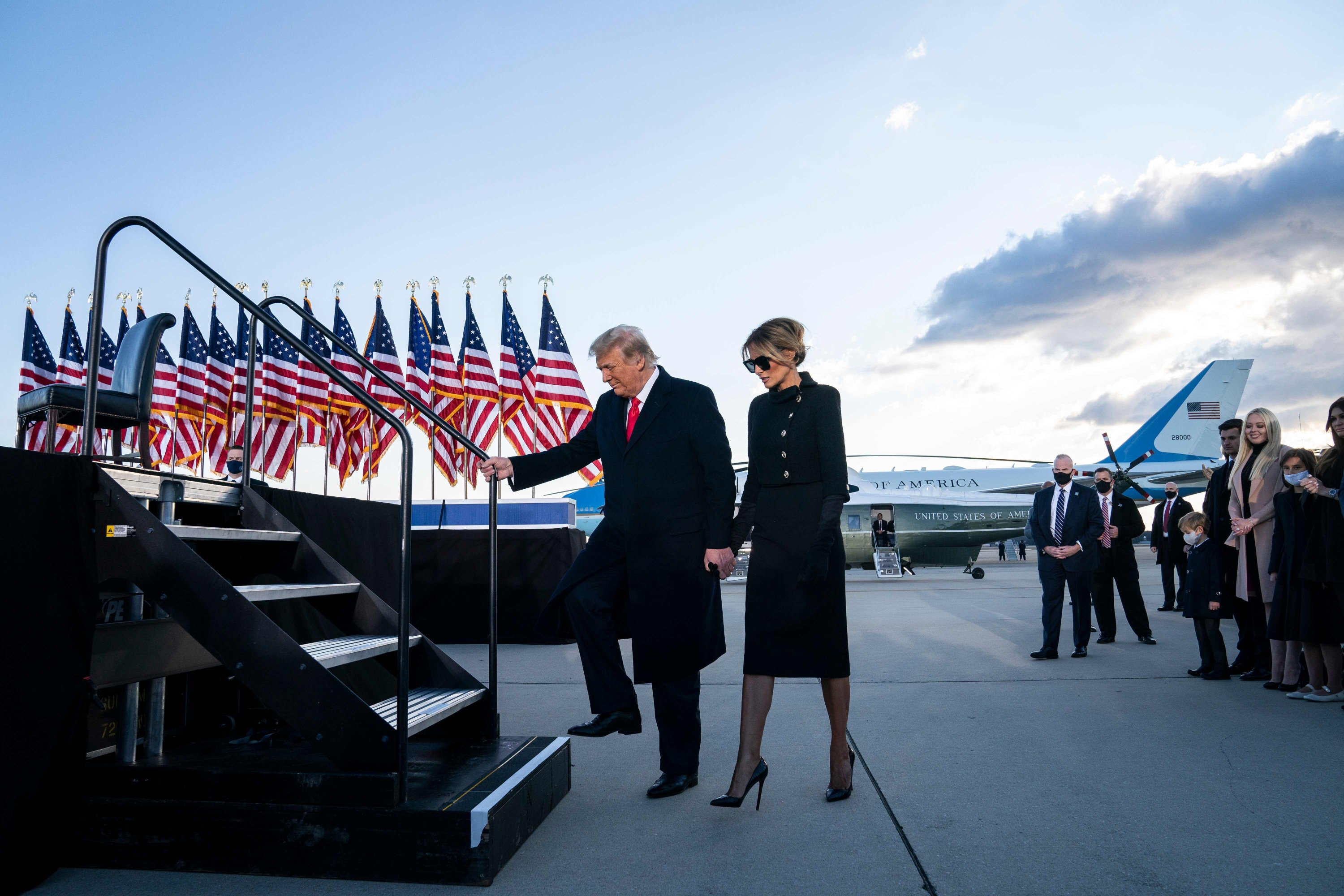Outgoing U.S. President Donald Trump and first lady Melania Trump take the stage prior to delivering remarks at Joint Base Andrews, Maryland, U.S., Jan. 20, 2021. (AFP Photo)