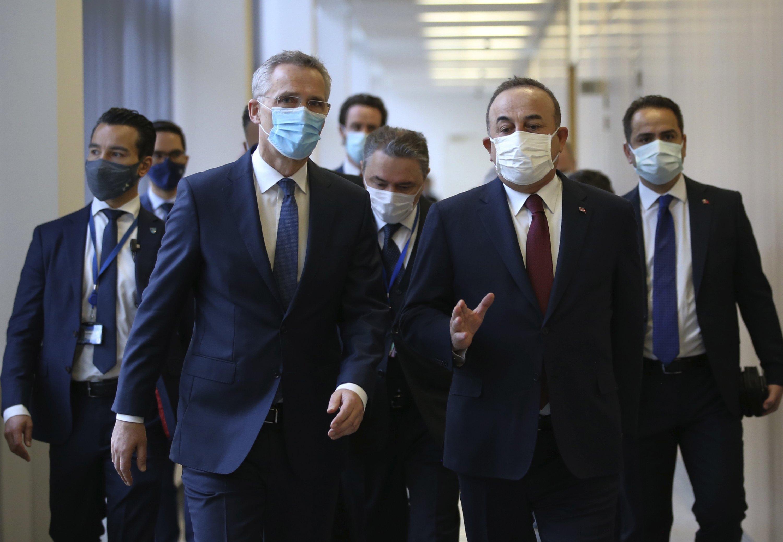 Foreign Minister Mevlüt Çavuşoğlu, right, and NATO Secretary-General Jens Stoltenberg speak prior to their meeting, in Brussels, Belgium, Jan. 22, 2021. (Fatih Aktas/Turkish Foreign Ministry via AP, Pool)