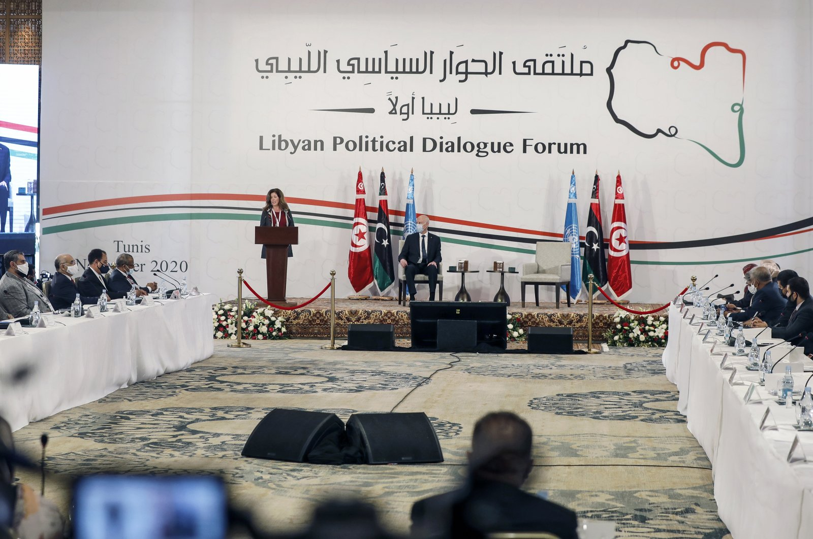 Stephanie Williams, acting special representative of the secretary-general and head of the United Nations Support Mission in Libya, (L) and Tunisian President Kais Saied attend the opening ceremony of Libya's peace talks in Tunis, Tunisia, Nov. 9, 2020. (AP File Photo)