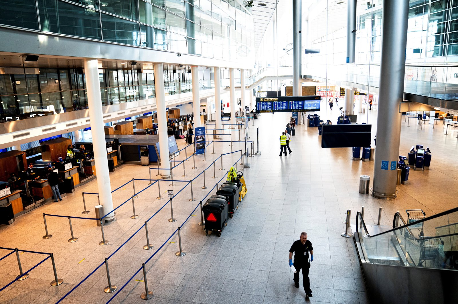 Copenhagen Airport's Terminal 3 hall is seen almost empty following the outbreak of the coronavirus disease after the country's lockdown, in Copenhagen, Denmark, March 24, 2020. (Reuters Photo)