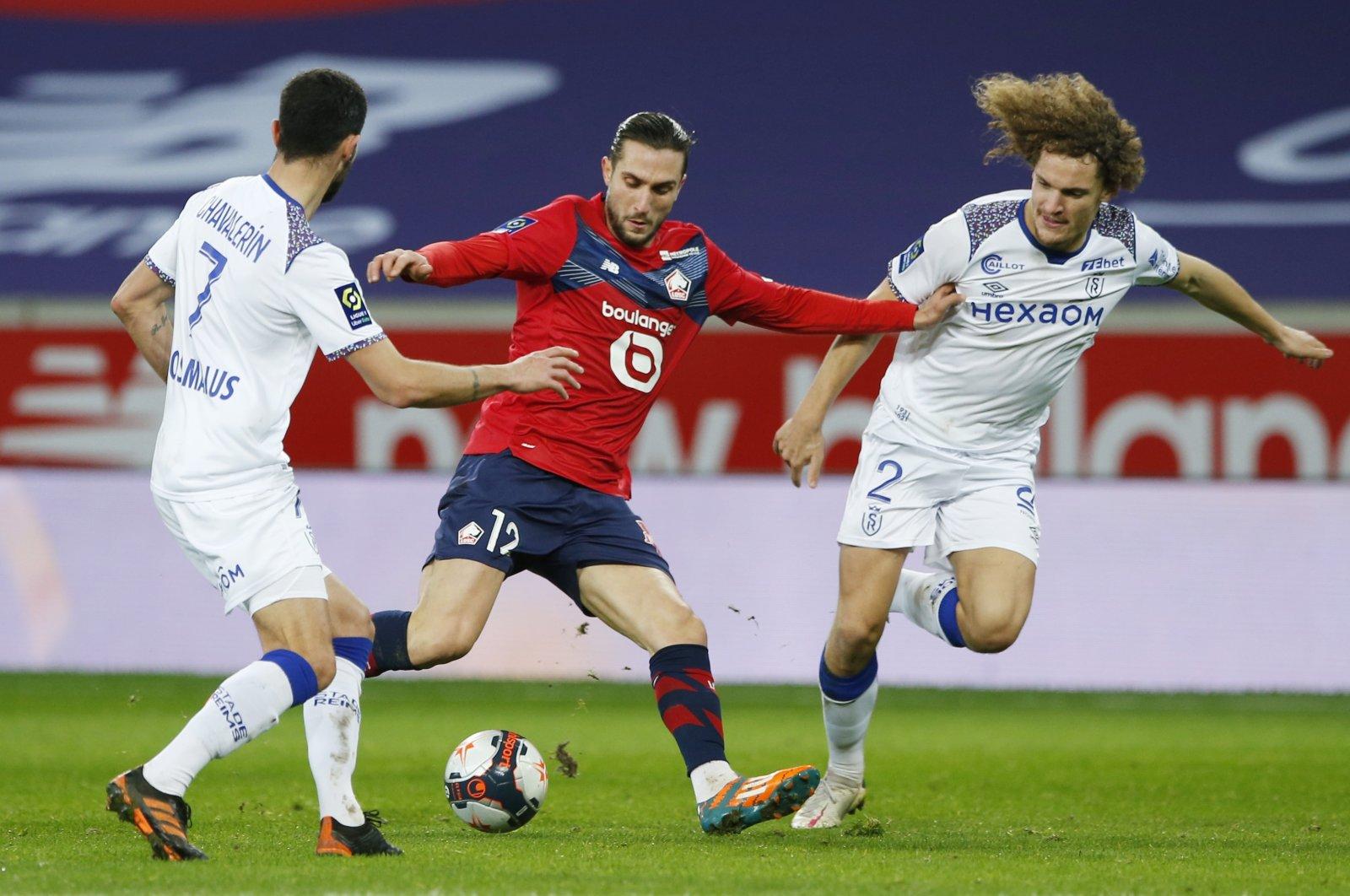 Lille's Yusuf Yazıcı (C) in action against Stade de Reims, Stade Pierre-Mauroy, Lille, France, Jan. 17, 2021. (Reuters Photo)