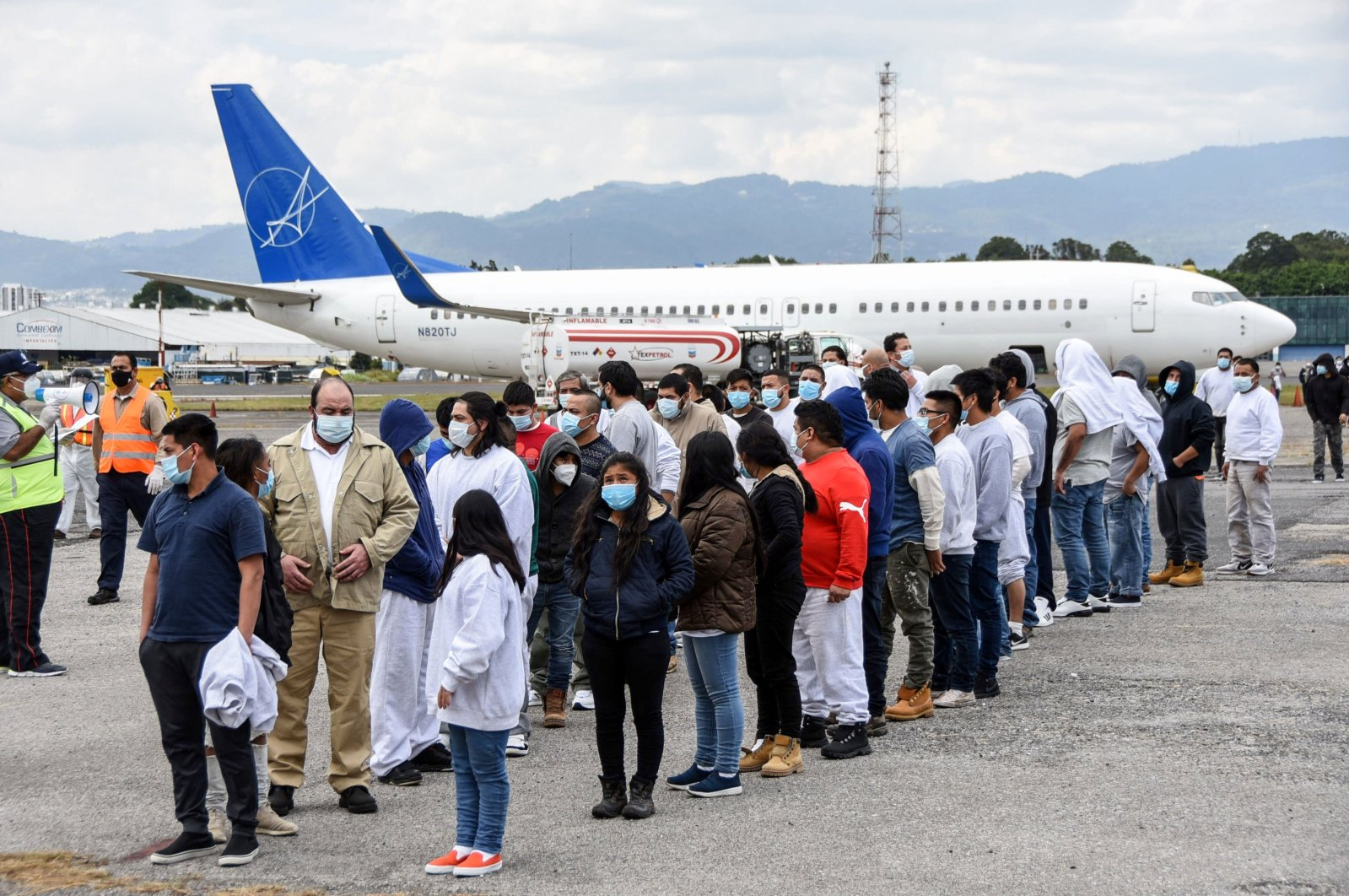Guatemalan migrants deported from the United States, queue upon their arrival at the Air Force Base in Guatemala City on January 6, 2021. (AFP Photo)